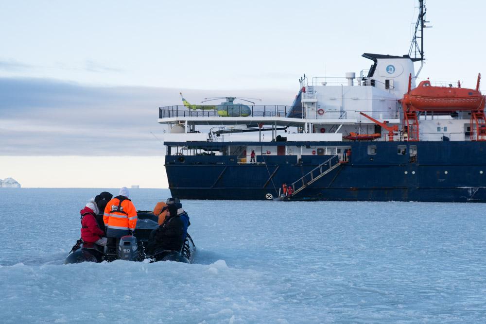 Zodiac crusing through pancake ice at Cape Washington, Terra Nova Bay, Victoria Land