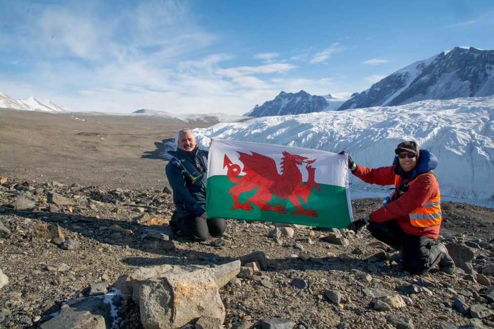 Myself and friend with Welsh flag at the Canada Glacier, Taylor Valley, McMurdo Dry Valleys