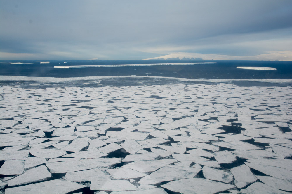 McMurdo Sound, with sea ice in the foreground and a 4 km long iceberg in the background
