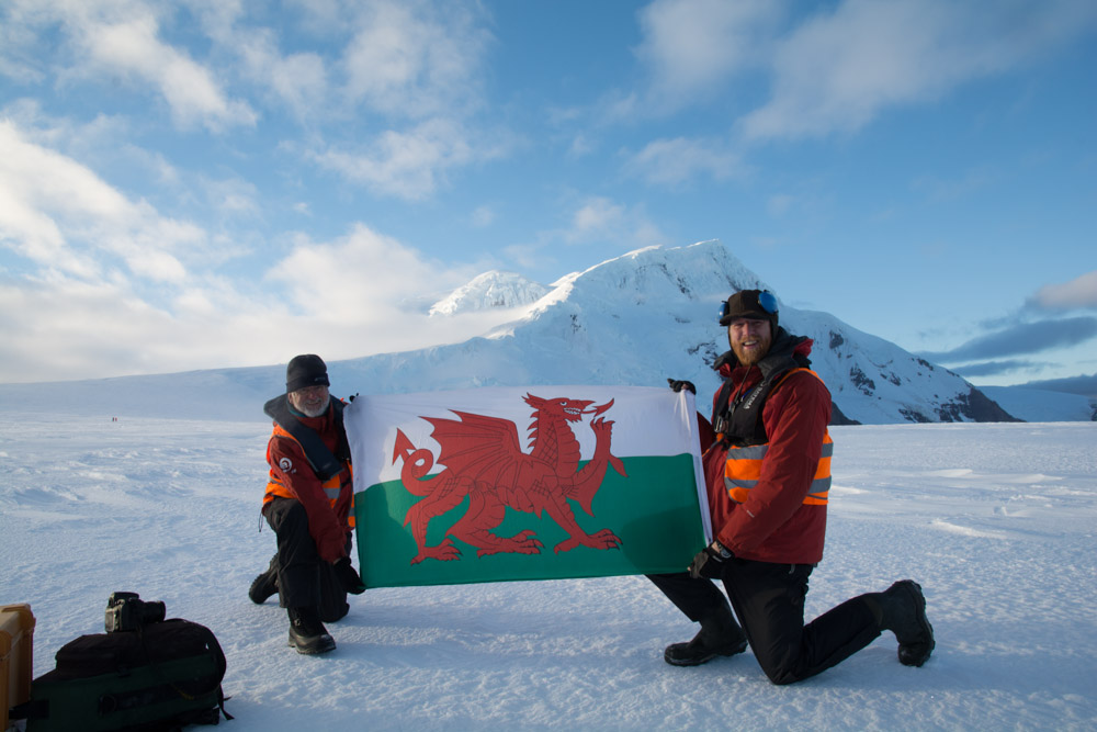 Myself and colleague with a Welsh flag on Peter 1 Island