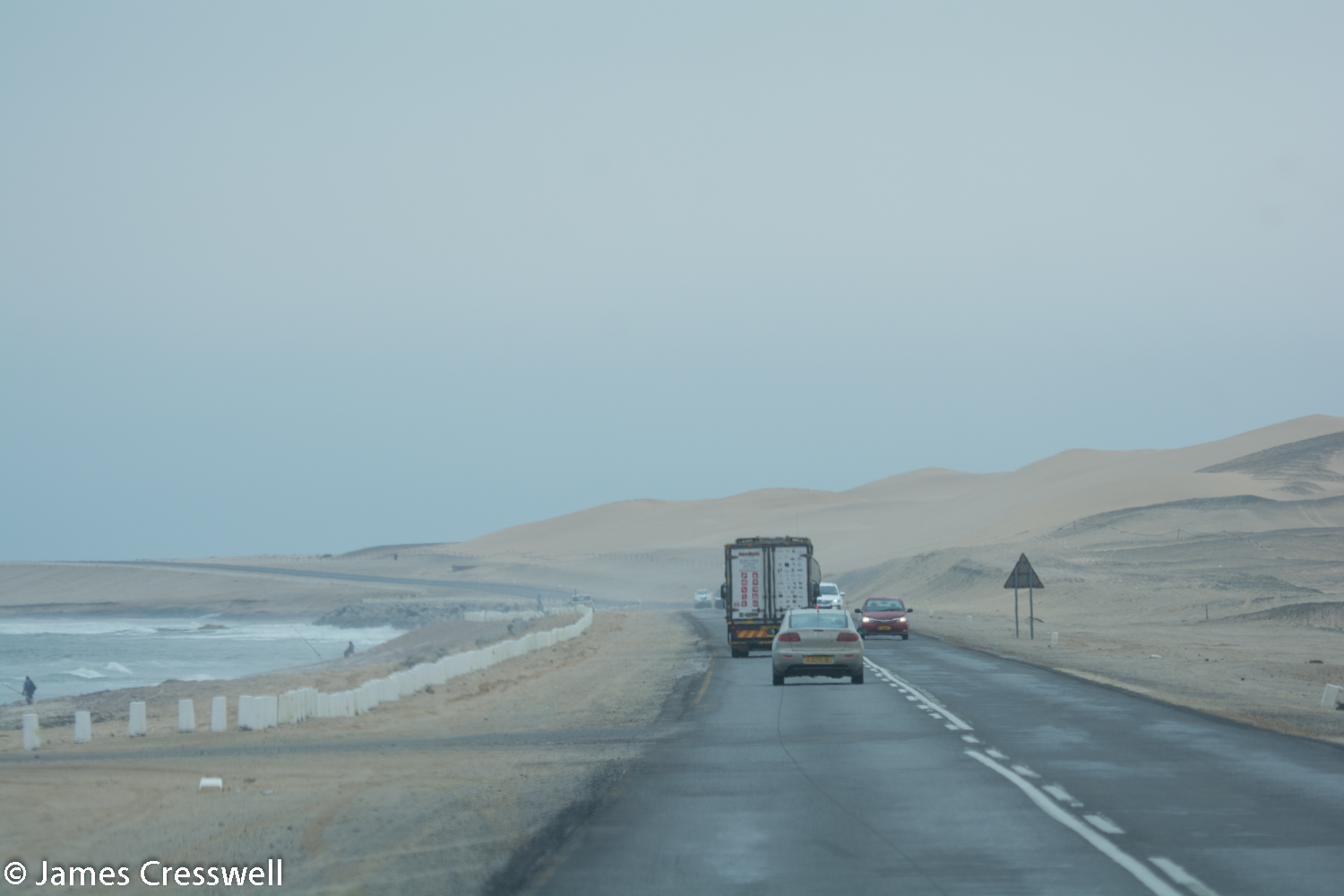The coast road between Walvis Bay and Swakopmund. Here the desert dunes reach the sea. The area is usually foggy due to the cold temperature of the sea.
