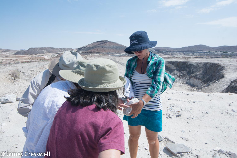 Nicole Grünert describing a piece of pegmatite at Uis mine, Namibia.
