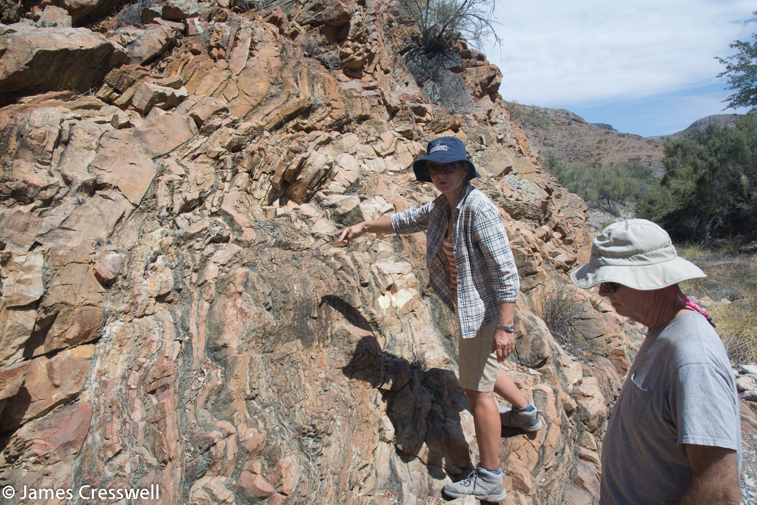 Nicole Grunnert points out folds in the carbonate rocks just above the Naukluft thrust fault