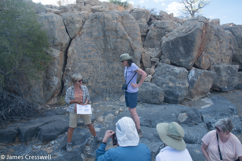 Nicole explaining the story of the stromatolites and Namacalathas fossils to the group