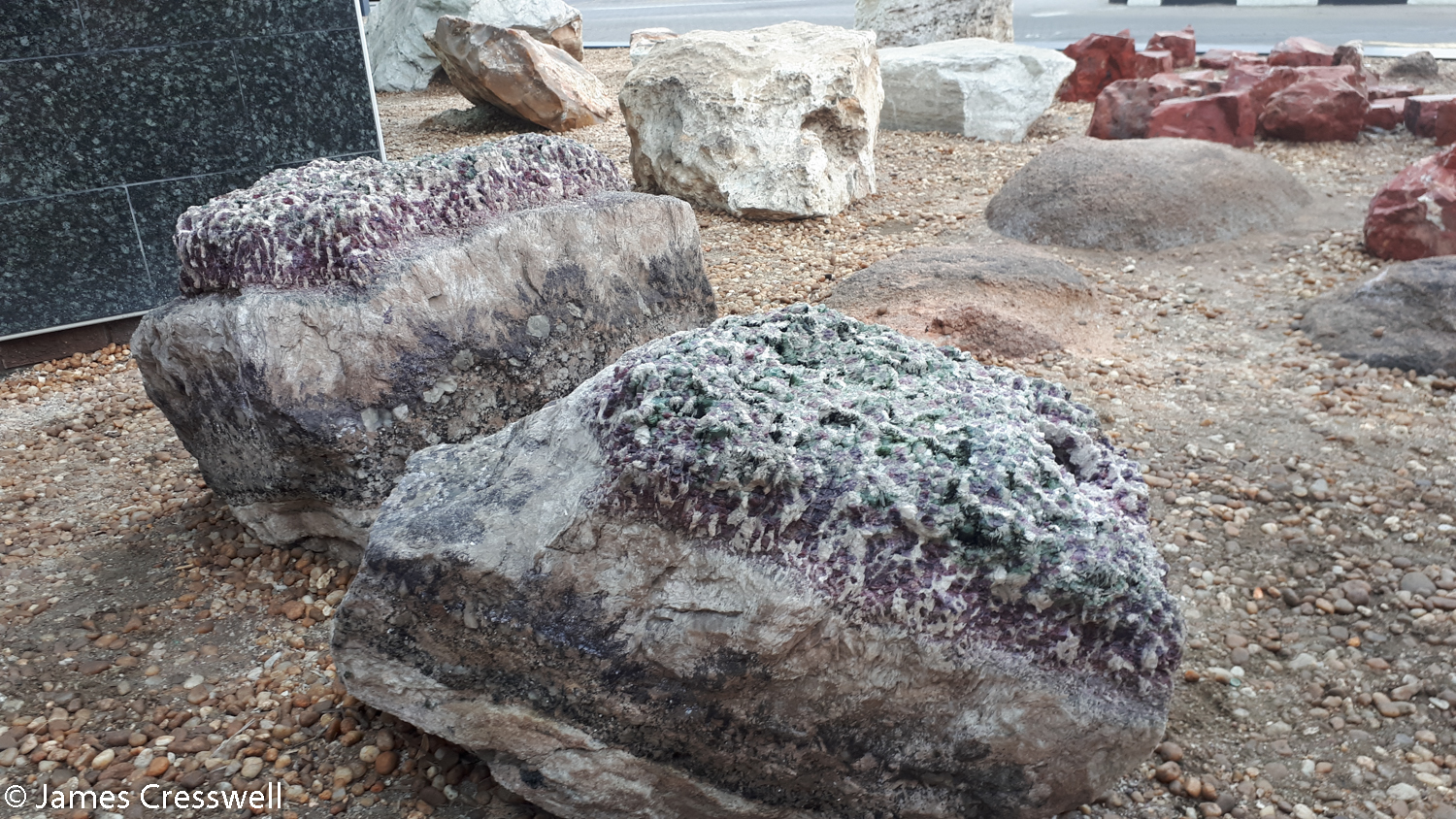 The crystal garden, at the Kristall Gallerie, Swakopmund, Namibia, which had many minerals e.g. tourmaline, amethyst, and flourite inside the pegmatite dykes they were mined from.