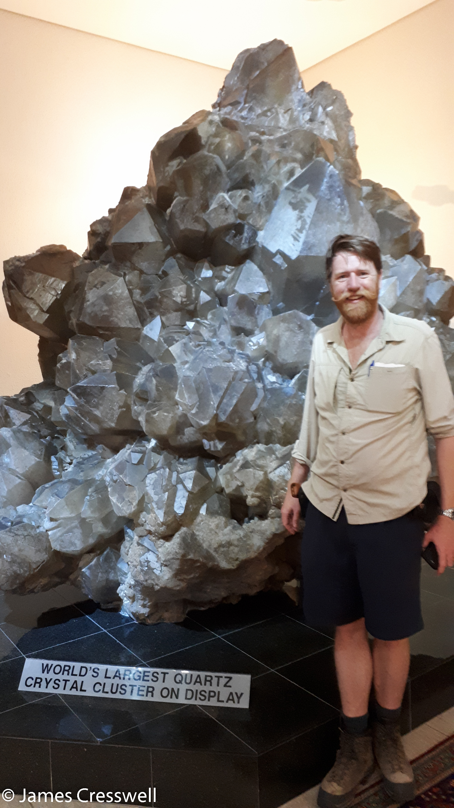 James Cresswell with the world's biggest quartz crystals that are on display, at the Kristall Gallerie, Swakopmund, Namibia.