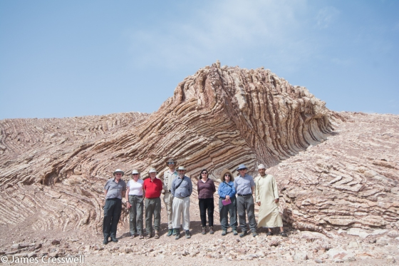 "Our GeoWorld Travel group at the ""Mother of All Outcrops"" - beds of red radiolarian cherts and white porcellanite"