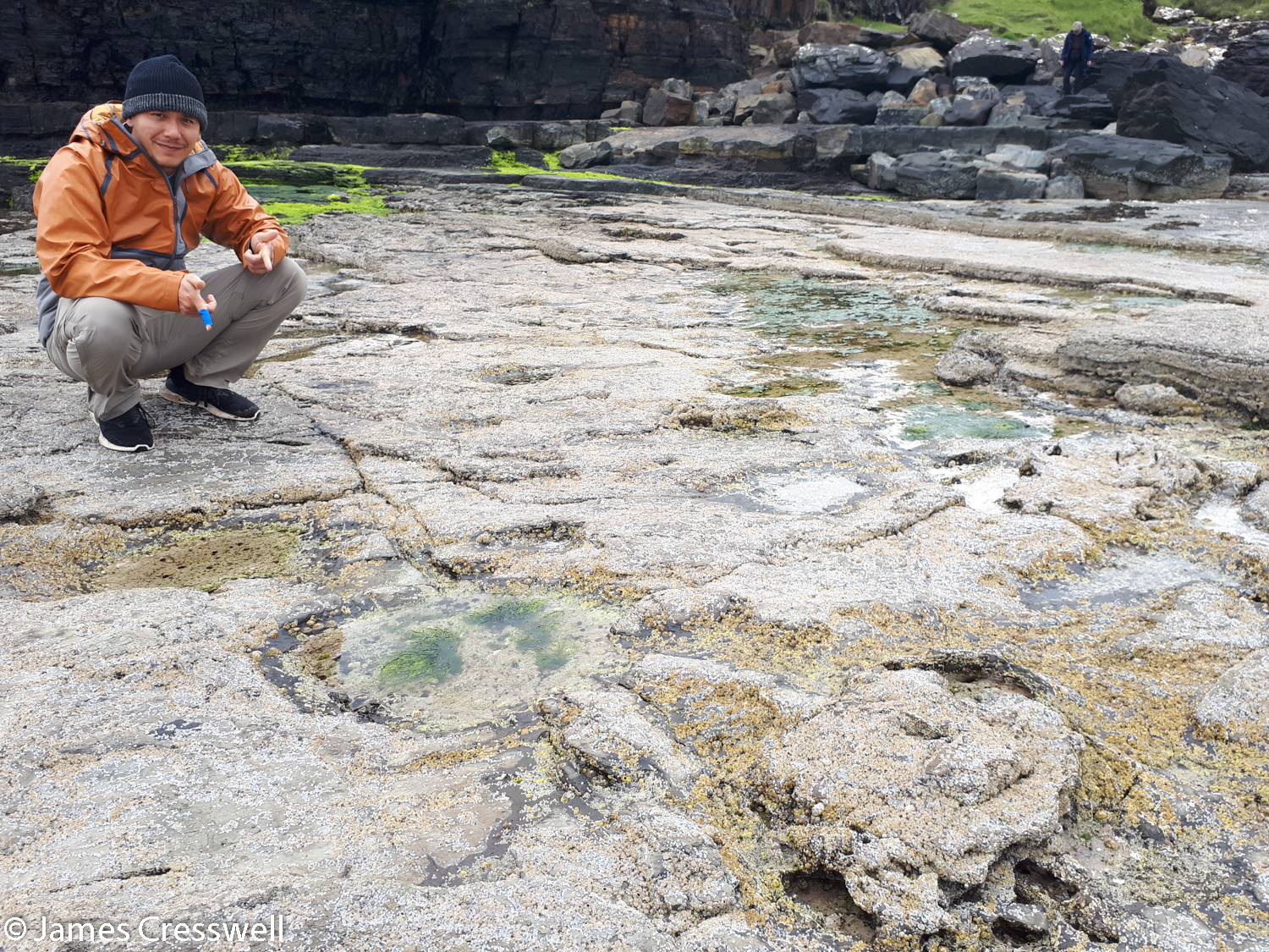 Charles with sauropod tracks at Brother's Point