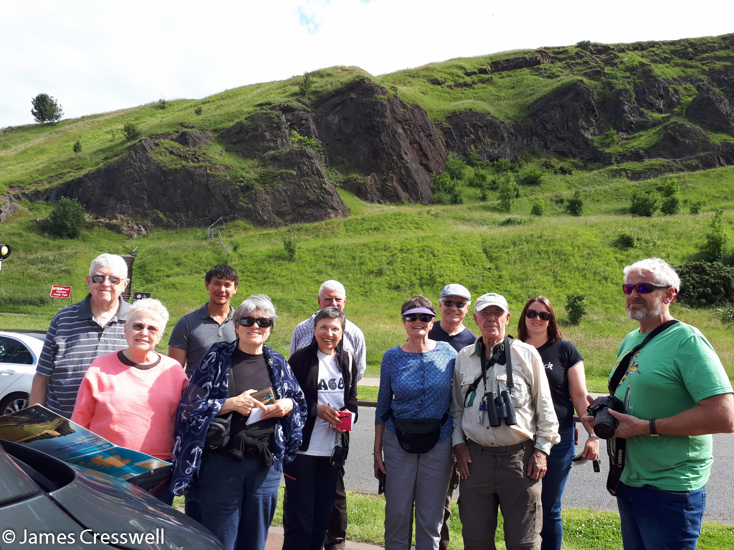 The GeoWorld Travel group in Holyrood Park with the Salisbury Crags sill of the Arthur's Seat volcano in the background