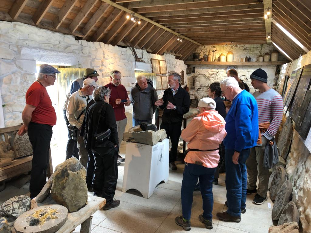 Dugald Ross explaining his fossils to our group in the Staffin Museum
