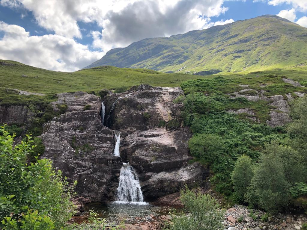 Waterfall flows over a dyke in the Devonian Glencoe volcano