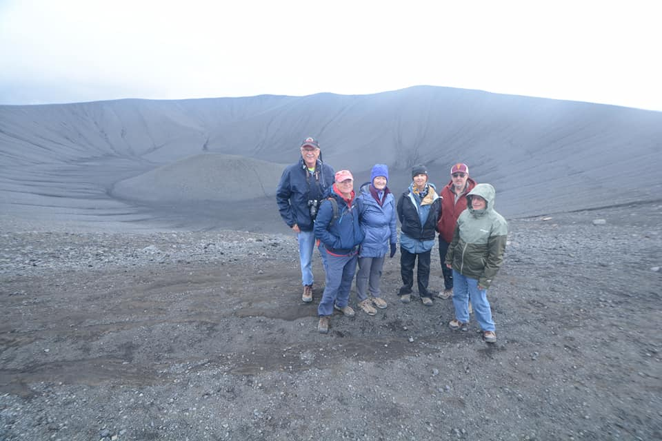 Group at the edge of a volcanic crater