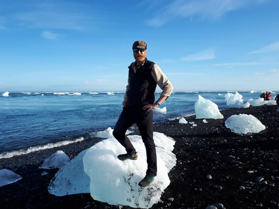 Man standing on small iceberg