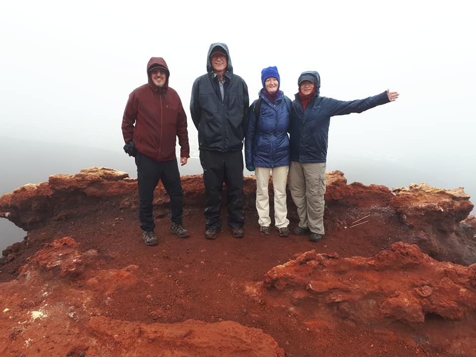 People on summit of volcano