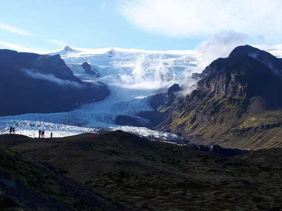 View of glacier flowing off a mountain