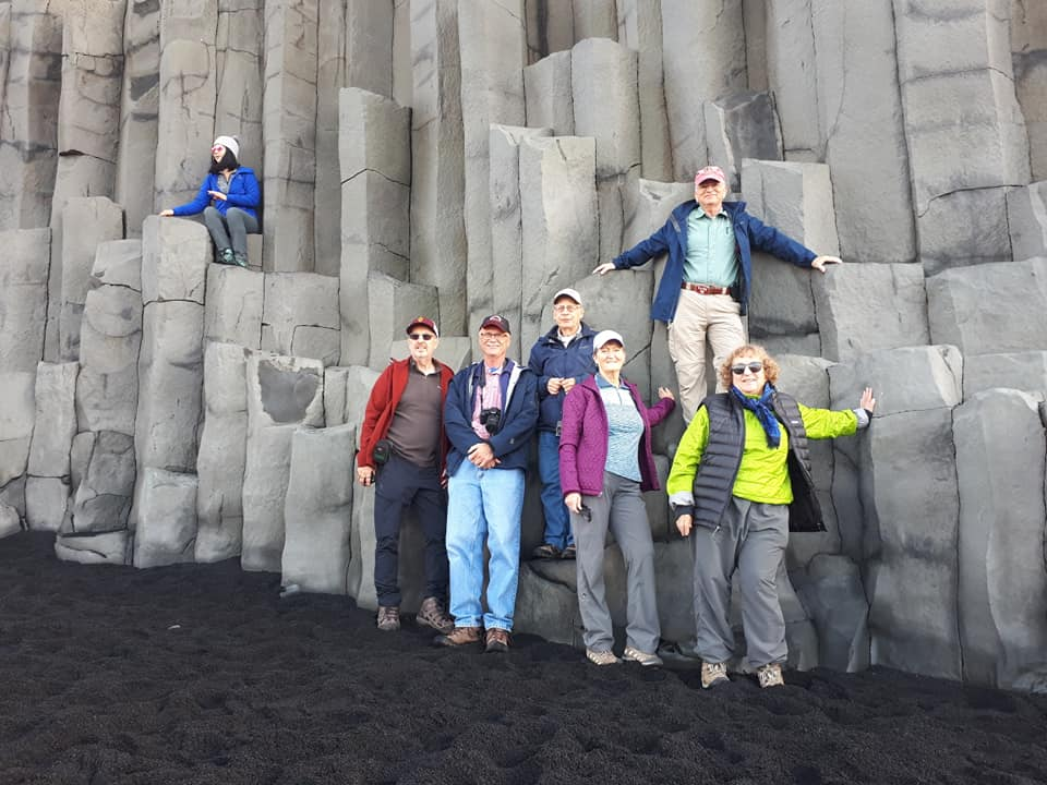 People in front of columnar basalt