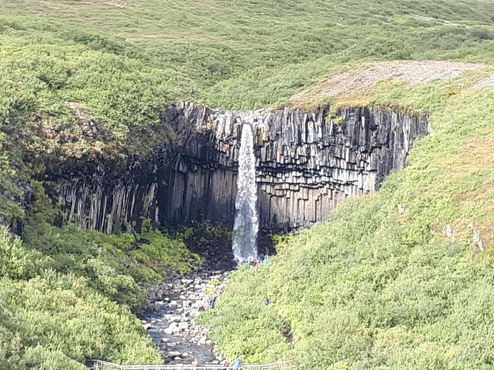 Waterfall flowing over columnar basalt