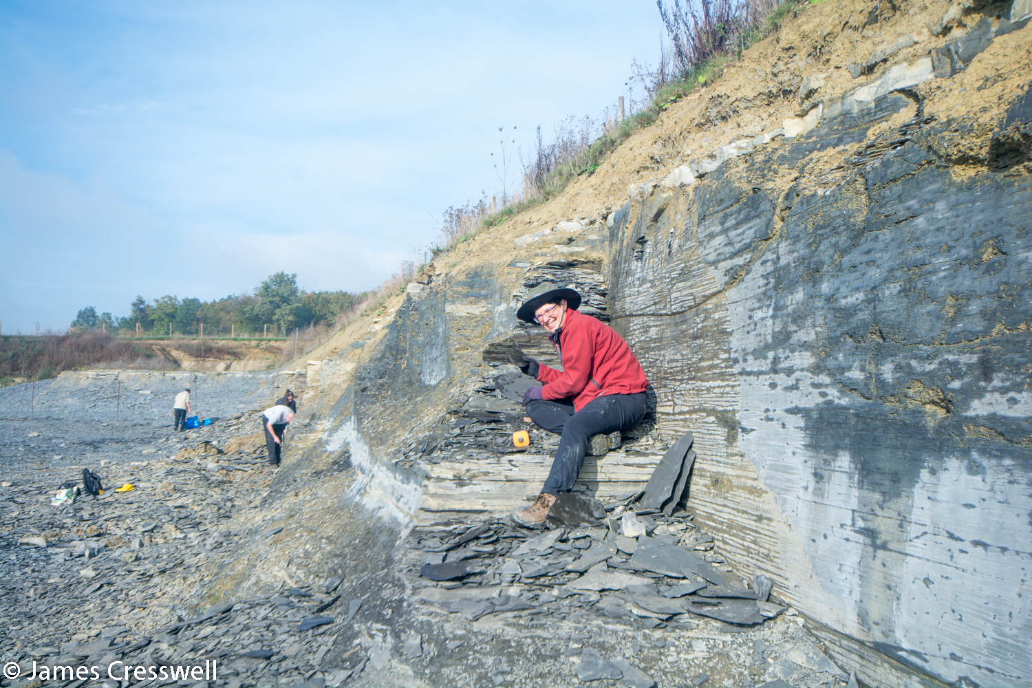 Lady finding fossils in quarry