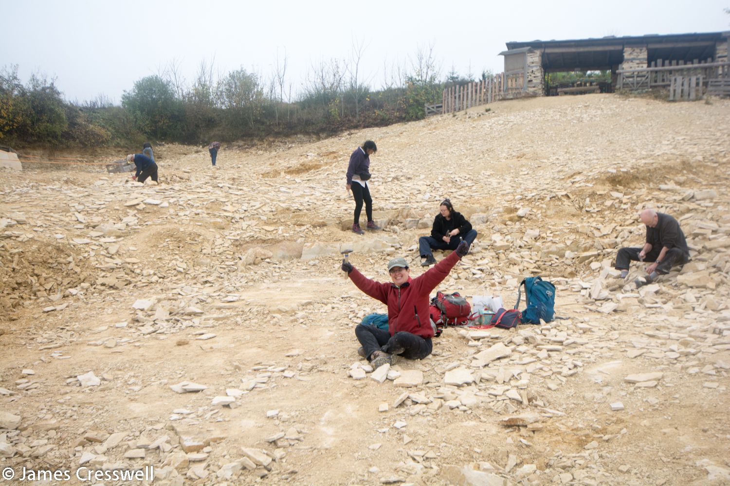 People looking for fossils in a quarry