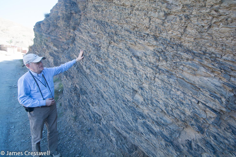 Man looking at Cambrian marine sediments