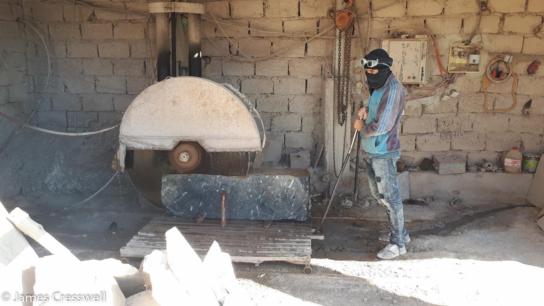 Man working by a cutting machine