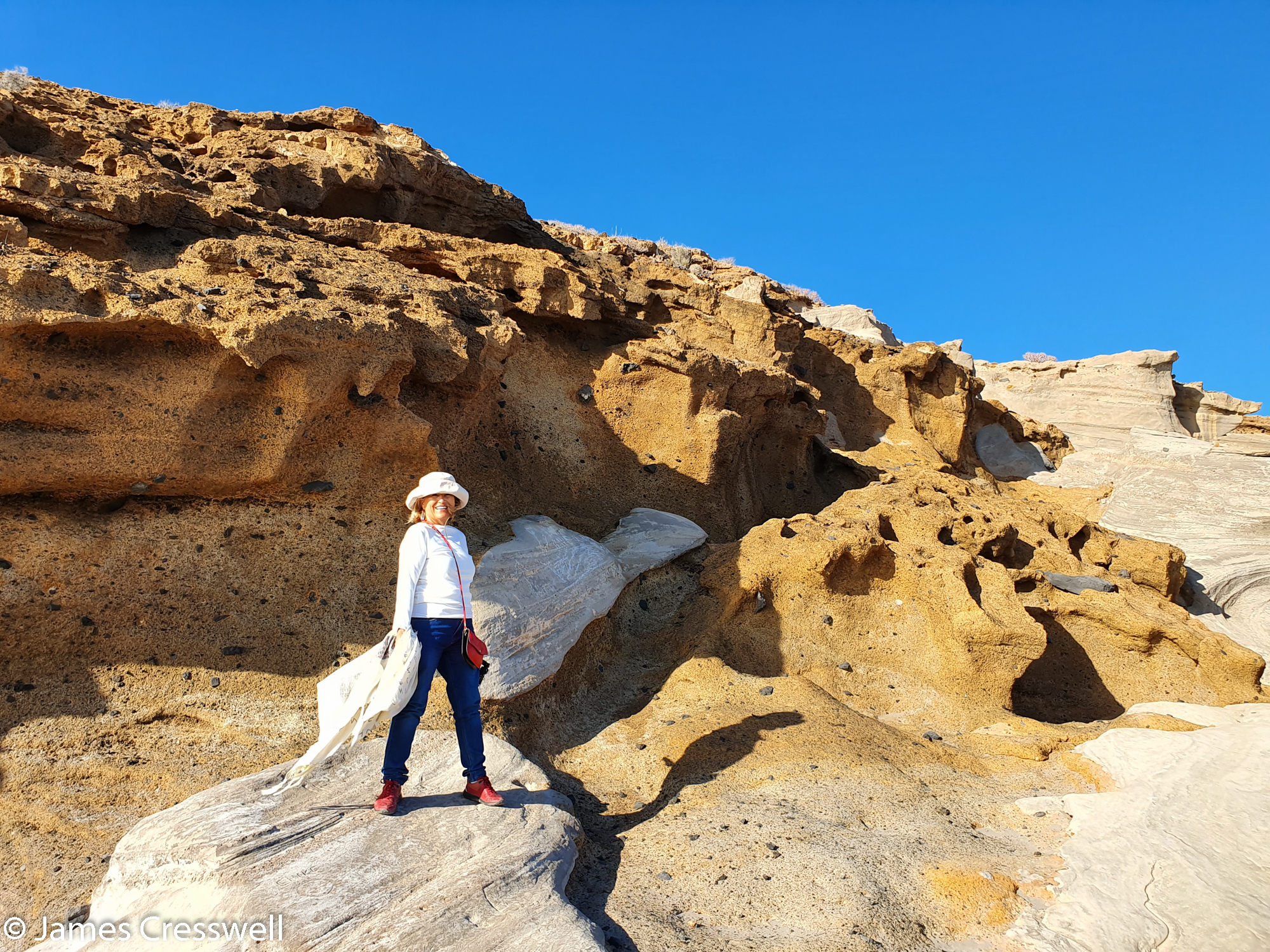 Woman standing on fossilised beach dunes