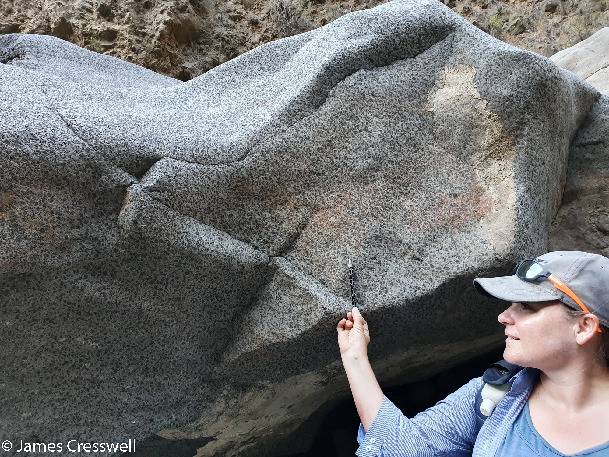 Woman pointing out a geological feature