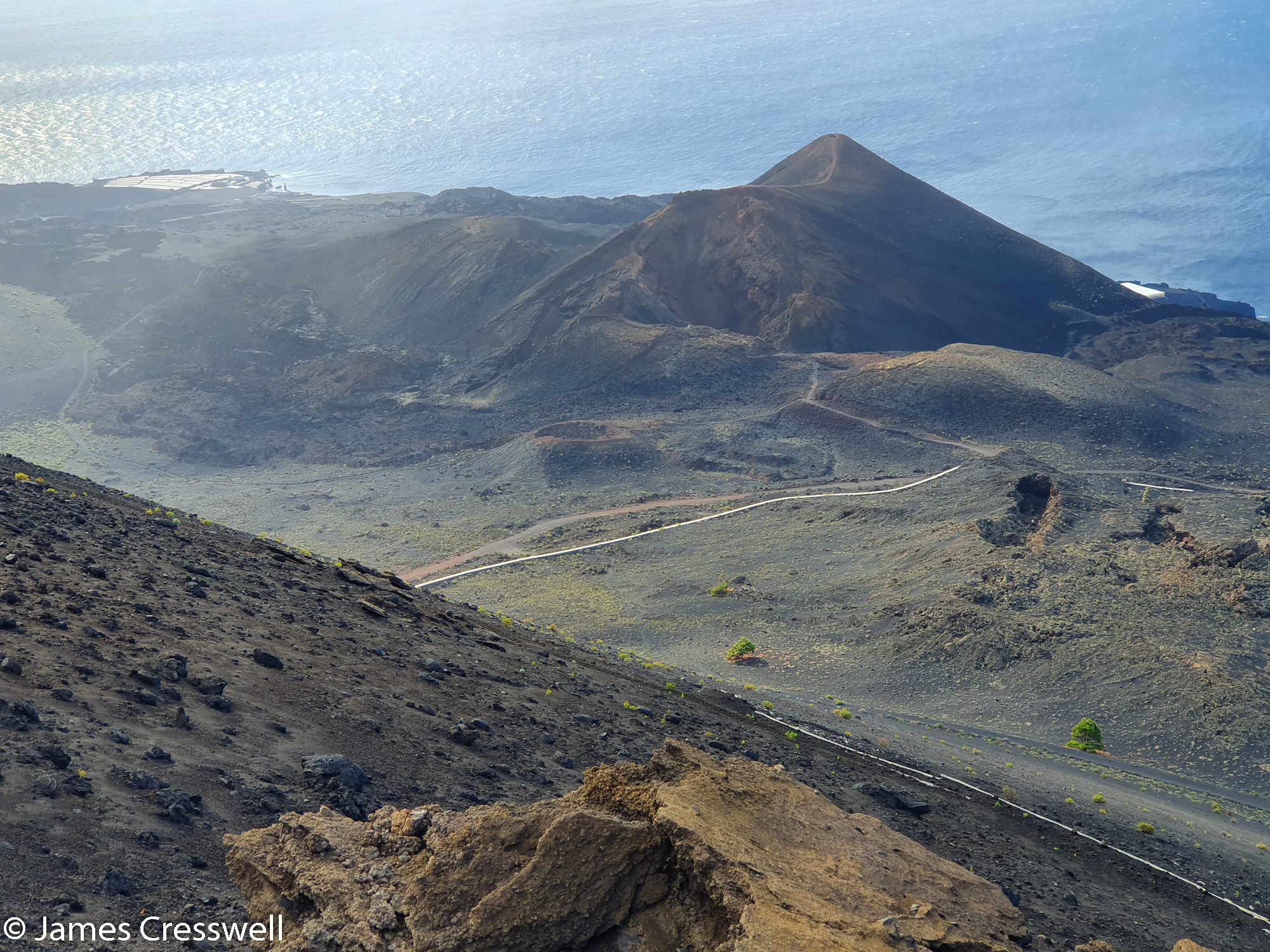 View of the sea with volcanic crater in the foreground