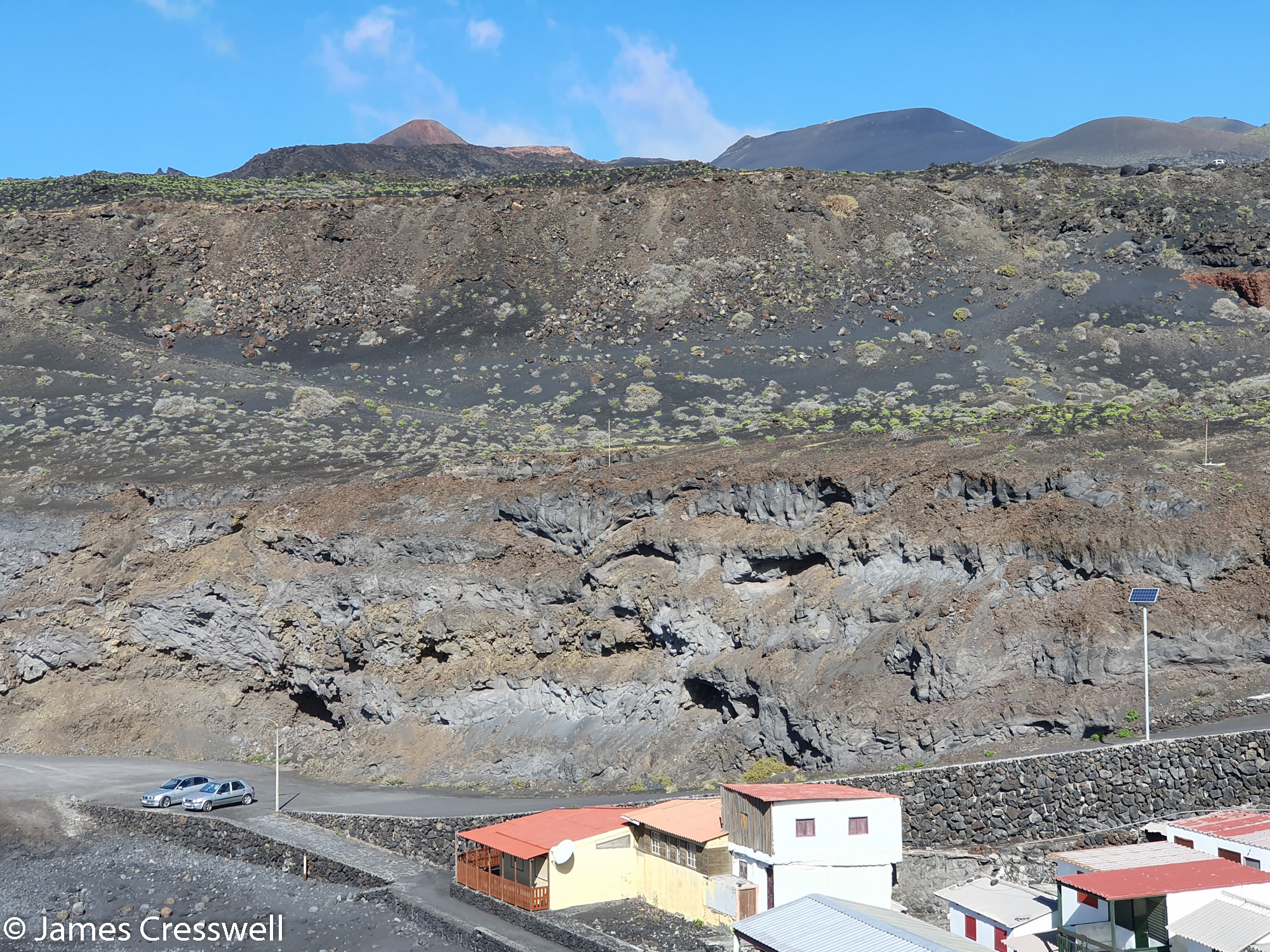 Solidified lava flows behind some houses