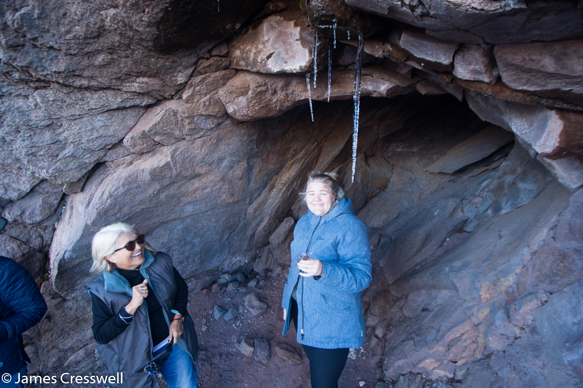 Women in a cave with icicles hanging down
