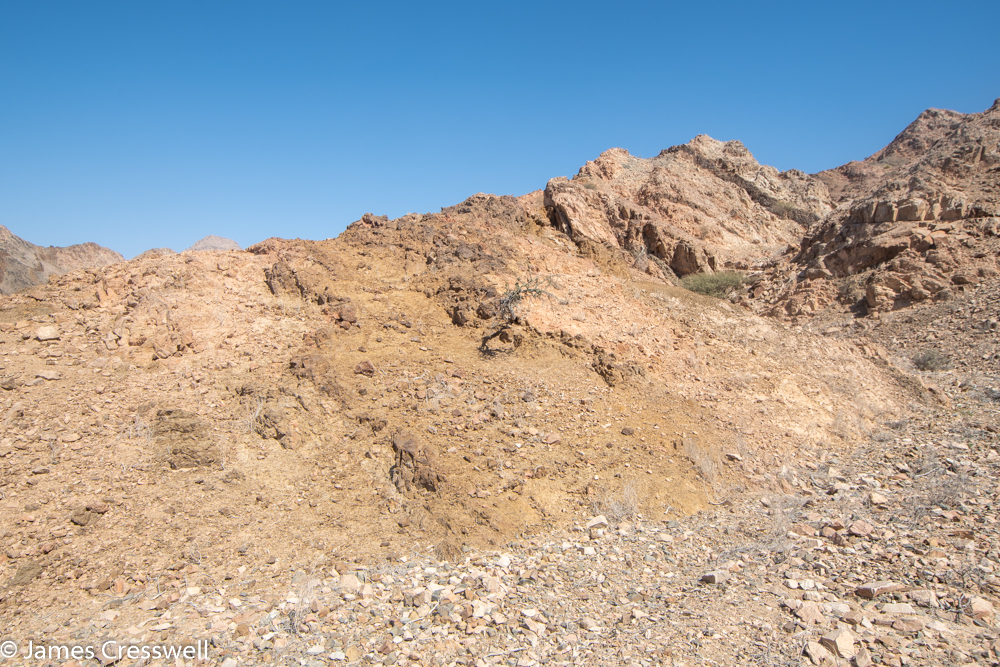 A photograph of a rocky hillside
