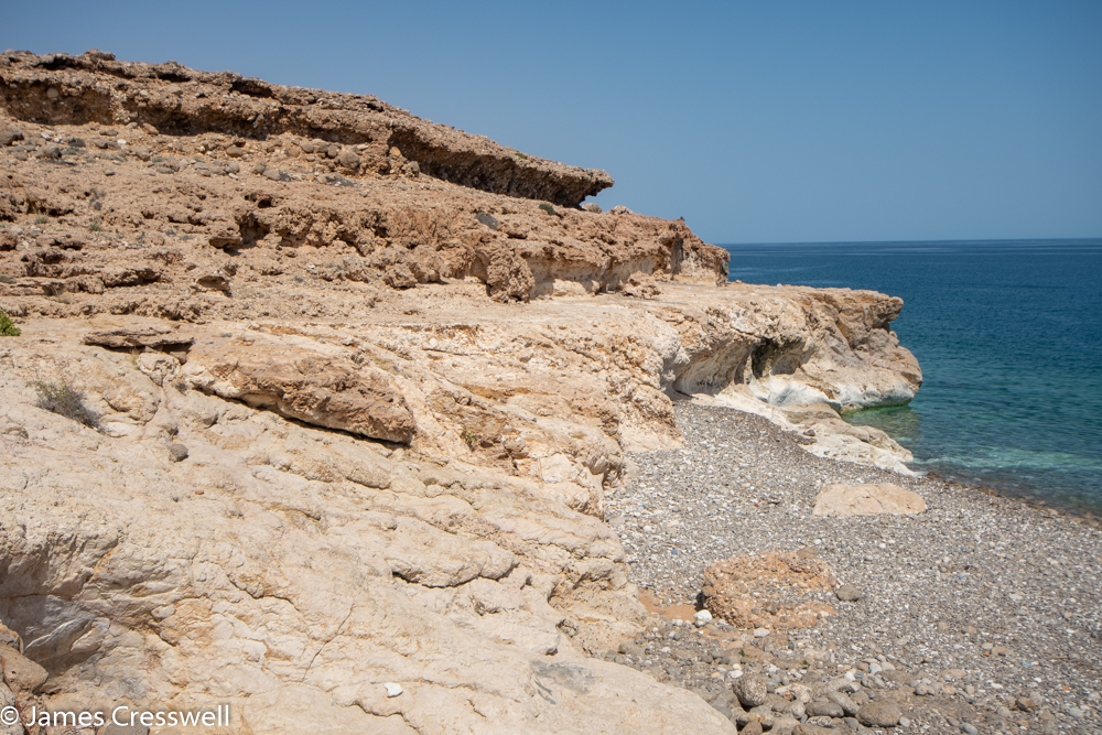 A photograph of a small stepped sea cliff