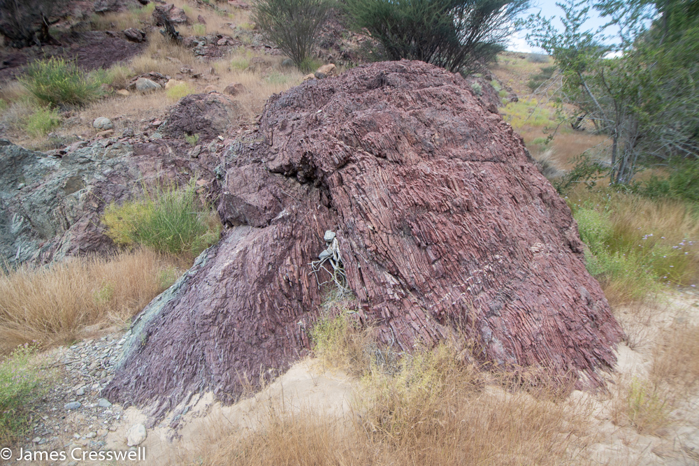 A photograph of a red layered rock