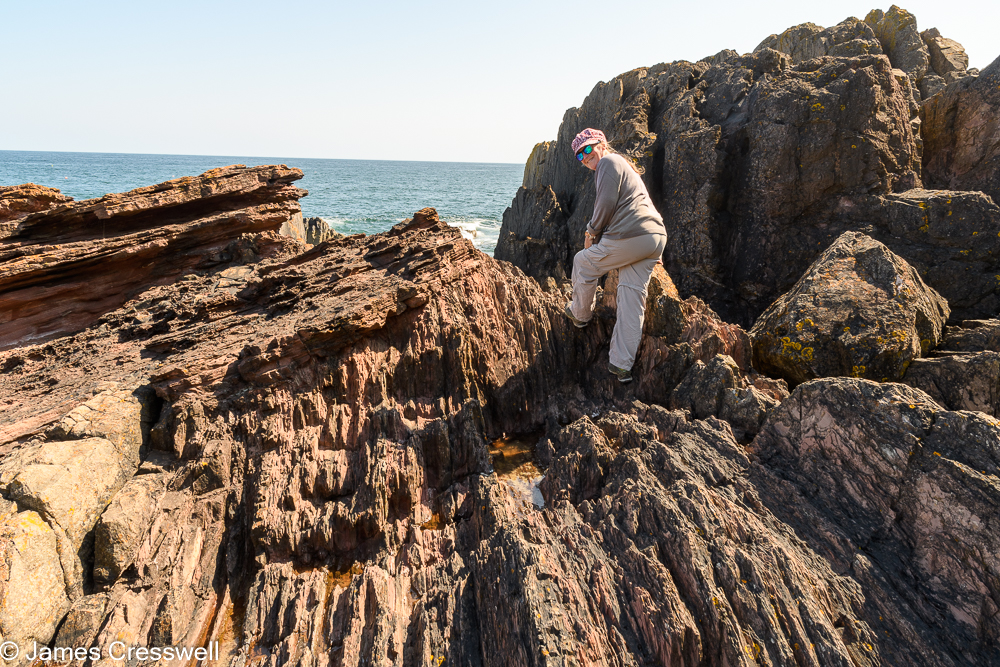 A woman standing on rocks