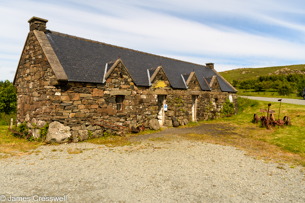 A stone one storey building with a pitched roof