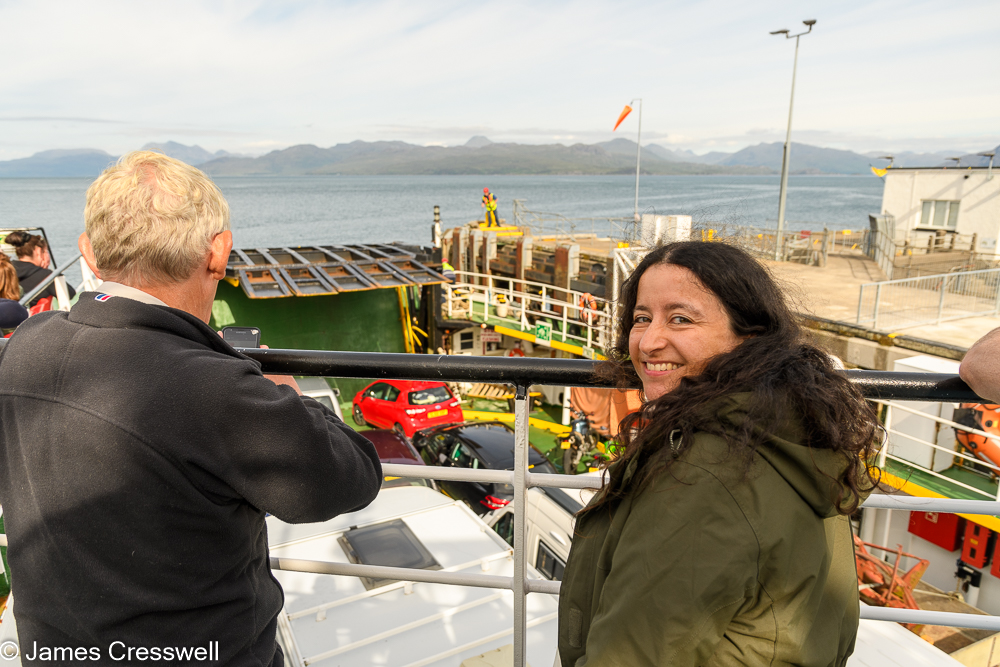 A man and a woman standing on a car ferry