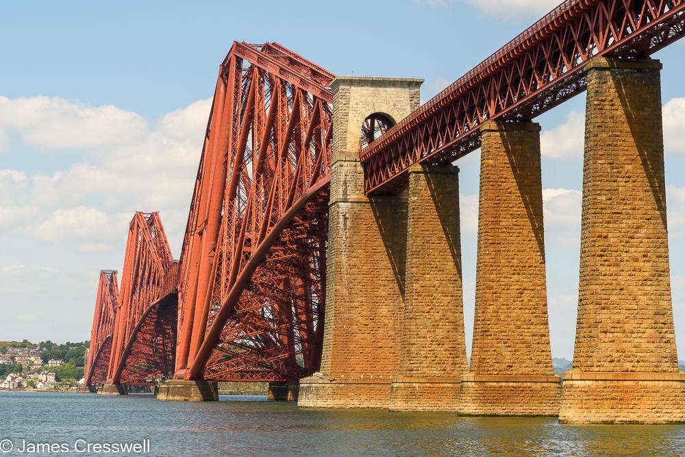 A large red metal bridge