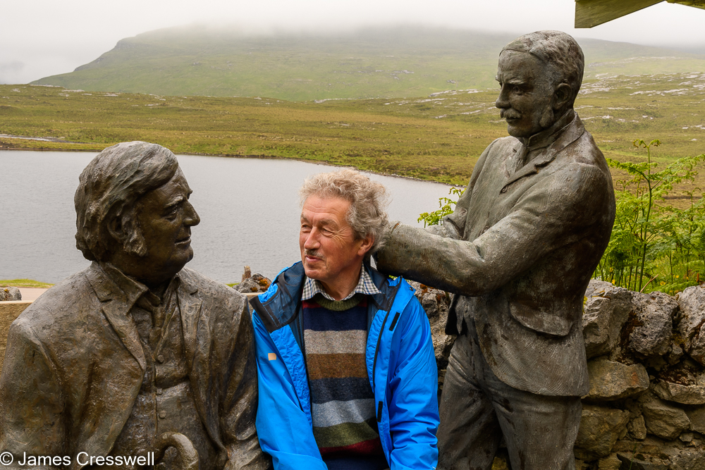 A man in-between two statues