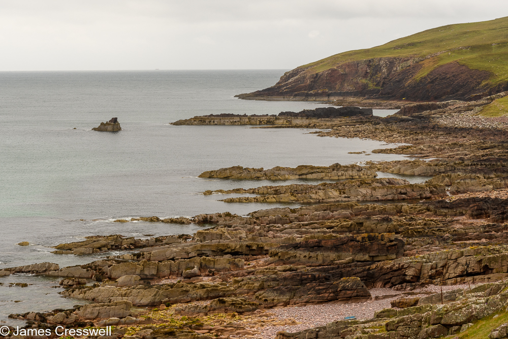 A coastline made up of layered rock