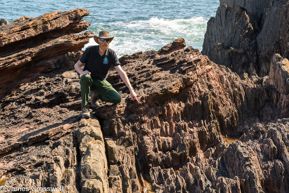 James Cresswell points to Hutton's Unconformity at Siccar Point